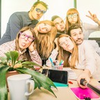 "A group of young adults making very silly faces. So called ""adulting classes"" have sprung up to teach life skills to Millennials."