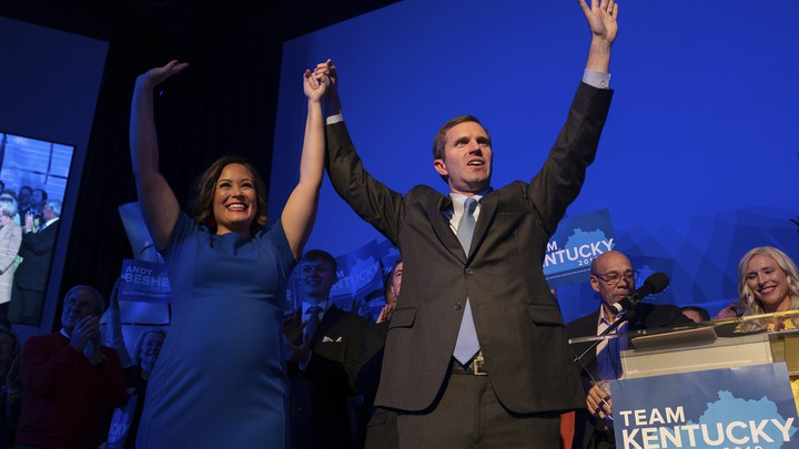 Andy Beshear celebrates his apparent win in Kentucky's governor's race on Tuesday night.