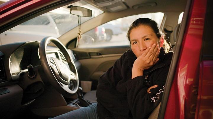 Alma Alvarez sitting in the front seat of her car