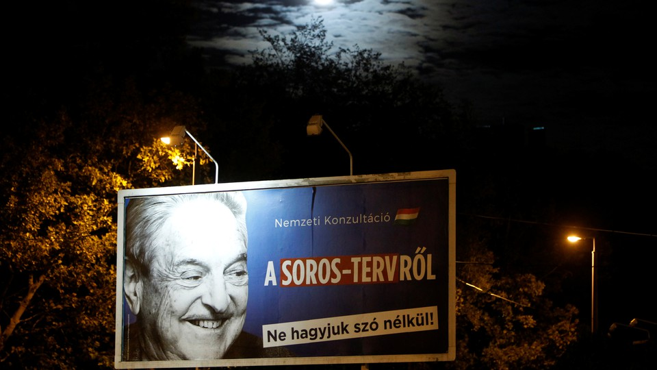 A billboard in Budapest, Hungary, with an image ofthe philanthropist George Soros on it.