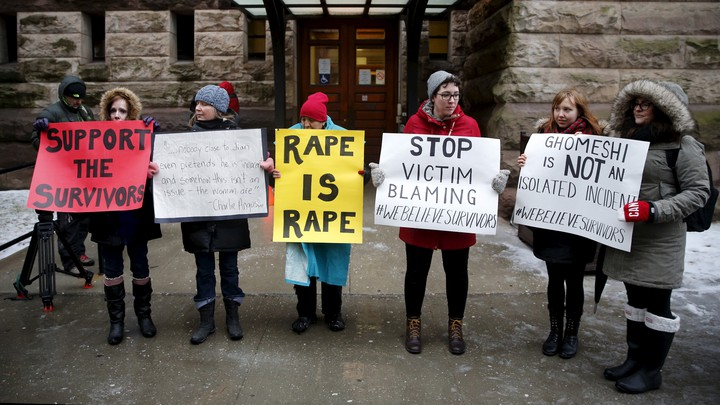 Protesters outside the court where Jian Ghomeshi was found not guilty on sexual assault charges, in Toronto on March 24, 2016.