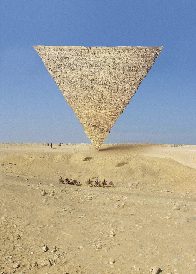 A pyramid balances on its point, upside down, in the desert with blue sky and small figures including a caravan of camels