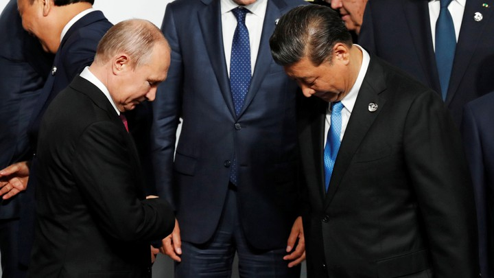 The Russian and Chinese president greet each other at the G20 summit.