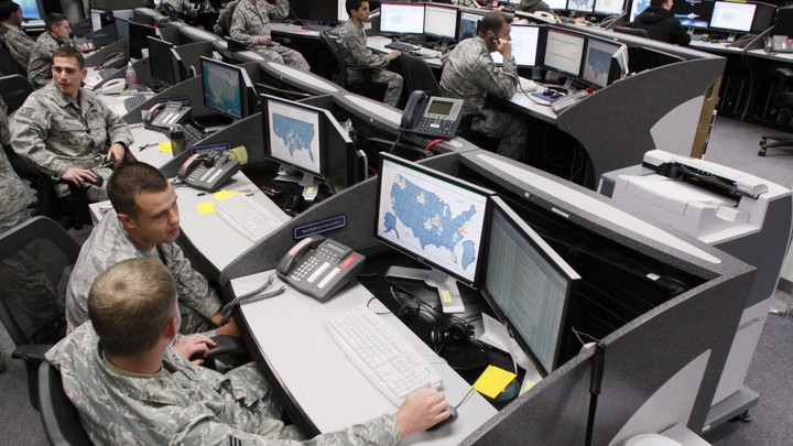 Personnel work at the Air Force Space Command Network Operations & Security Center at Peterson Air Force Base in Colorado Springs.