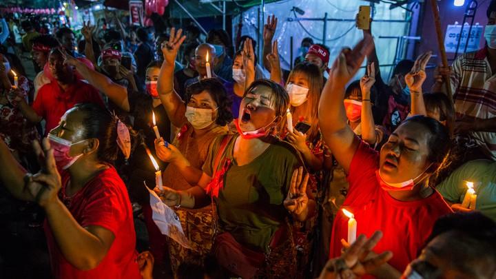 People march in a street in Yangon