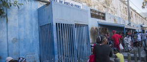People wait to visit inmates at the prison in Port-au-Prince.