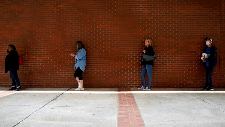 People waiting in line to file for unemployment benefits in Arkansas