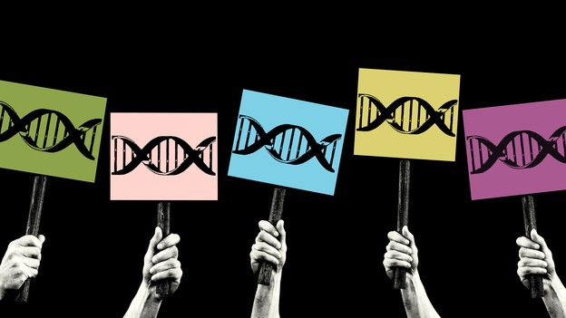 Hands hold up picket signs with DNA on them