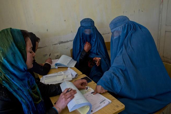Women in burqas vote