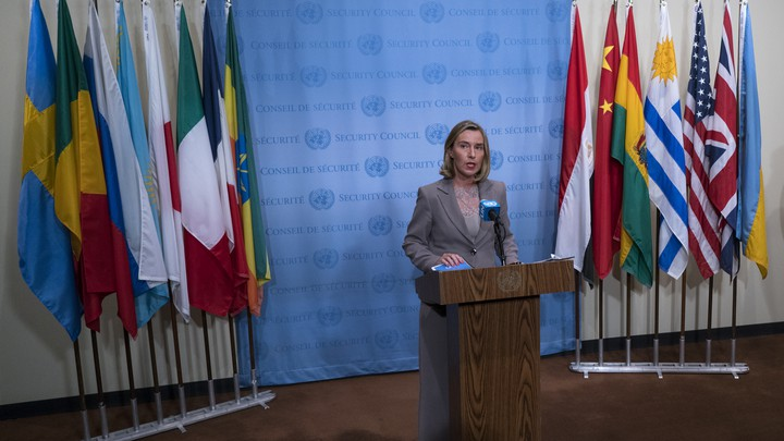 European Union foreign policy chief Federica Mogherini answers questions with flags of the Iran deal signatories behind her.