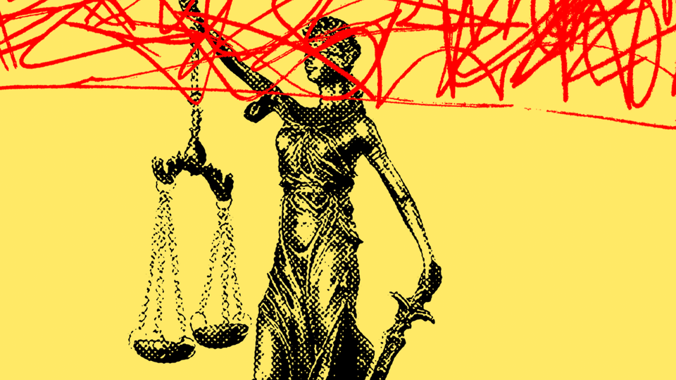 Lady Justice scrawled over with red
