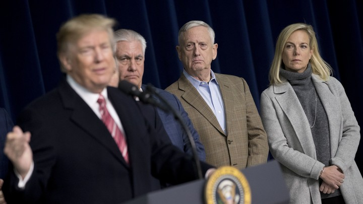 Rex Tillerson, James Mattis, and Kirstjen Nielsen watch Donald Trump.