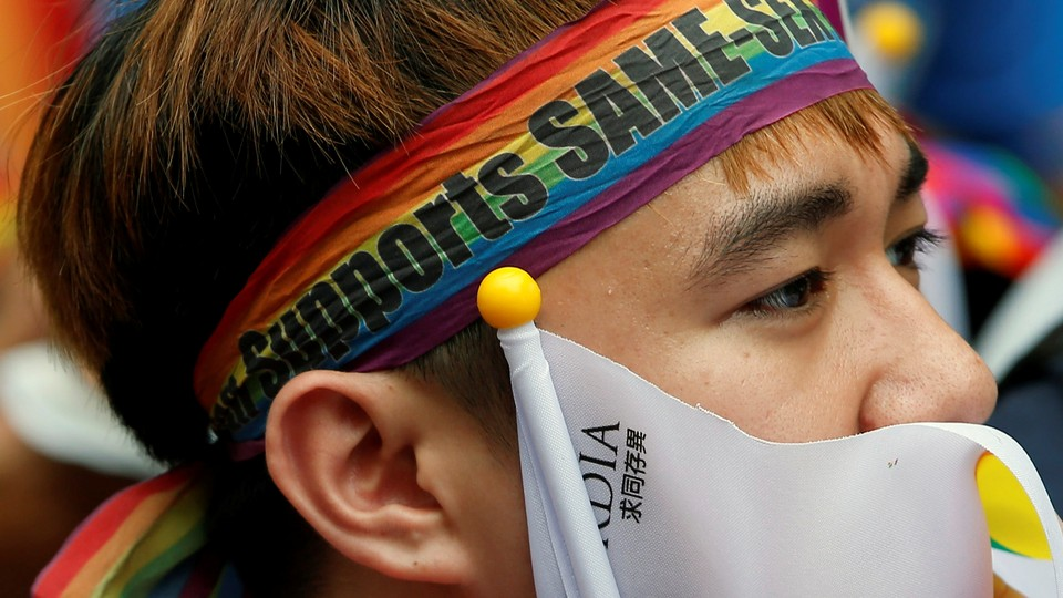 A supporter reacts to the Taiwanese constitutional court's rulingin Taipei, Taiwan on May 24, 2017.