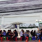 People eat their lunch at a street food shop in Bangkok, Thailand.