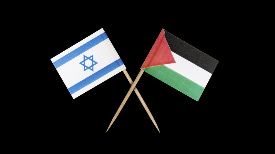 The Israeli and Palestinian flags, overlapping
