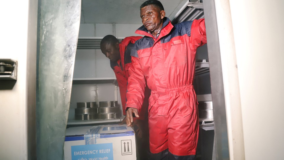 Congolese health officials arrange the first batch of experimental Ebola vaccines in Kinshasa.