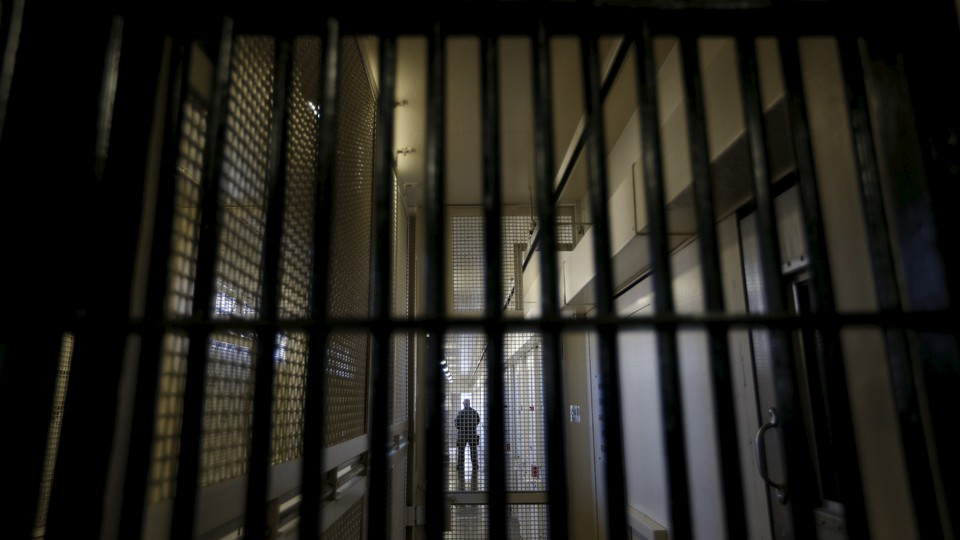 A shot from behind bars, looking into the Adjustment Center at San Quentin State Prison's death row