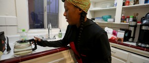 photo: Dominque Walker, founder of Moms 4 Housing, n the kitchen of the vacant house in West Oakland that the group occupied to draw attention to fair housing issues.