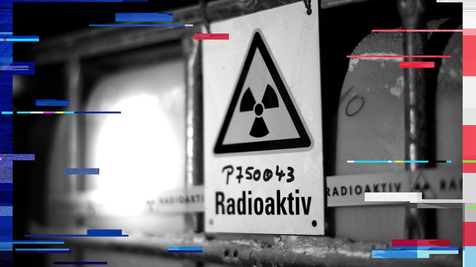 A radiation sign is attached to a barrel containing radioactive water at the Asse nuclear waste disposal centre in a unused mine near the German village of Remlingen