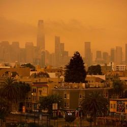 San Francisco with an orange sky, a result of the California wildfires.
