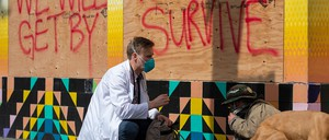 photo: Stuart Malcolm, a doctor with the Haight Ashbury Free Clinic, speaks with homeless people about the coronavirus in San Francisco.