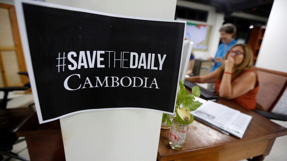 """A sign says """"Save The Daily Cambodia"""" in the newspaper's newsroom in September 2017"""