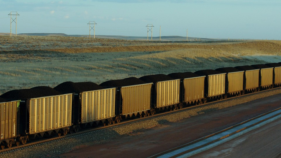 Freight cars of coal depart Wyoming in this 2006 file photo