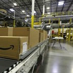 A package moves along a conveyer belt at Amazon's fulfillment center in DuPont, Washington.