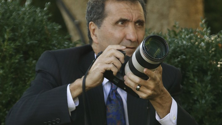 Pete Souza, the former director of White House photography, takes pictures of Barack Obama in the Rose Garden in 2013.