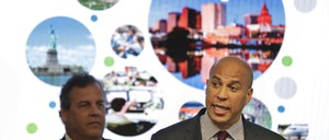 Senator Cory Booker (right) and then-New Jersey Governor Chris Christie during an announcement in Newark in October. Before leaving office, Christie signed off on $7 billion in tax breaks to Amazon in an effort to lure the company's second headquarters.