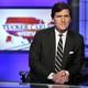 """Tucker Carlson, host of """"Tucker Carlson Tonight,"""" looks at the camera."""