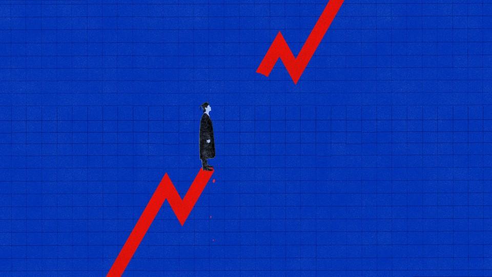 Man in graduation cap standing on trend line