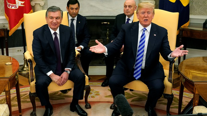 Donald Trump gestures as he meets with Shavkat Mirziyoyev at the White House.