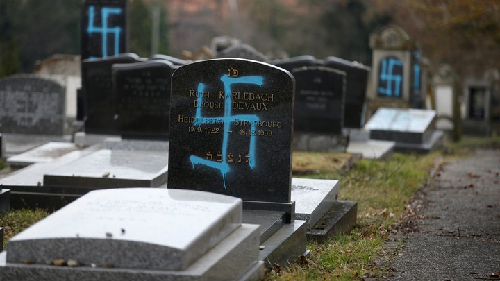 Graves desecrated with swastikas in a Jewish cemetery in France in February 2019