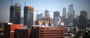 A photo of construction cranes and tall buildings in downtown Los Angeles.