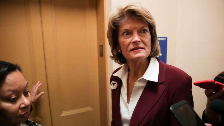 Senator Lisa Murkowski talking to reporters