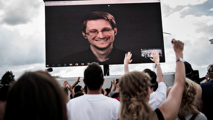 American whistleblower Edward Snowden is seen on a screen as he delivers a speech during the Roskilde Festival in Roskilde, Denmark, on June 28 2016.