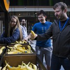 Amazon employees in Seattle enjoy a free banana vendor.