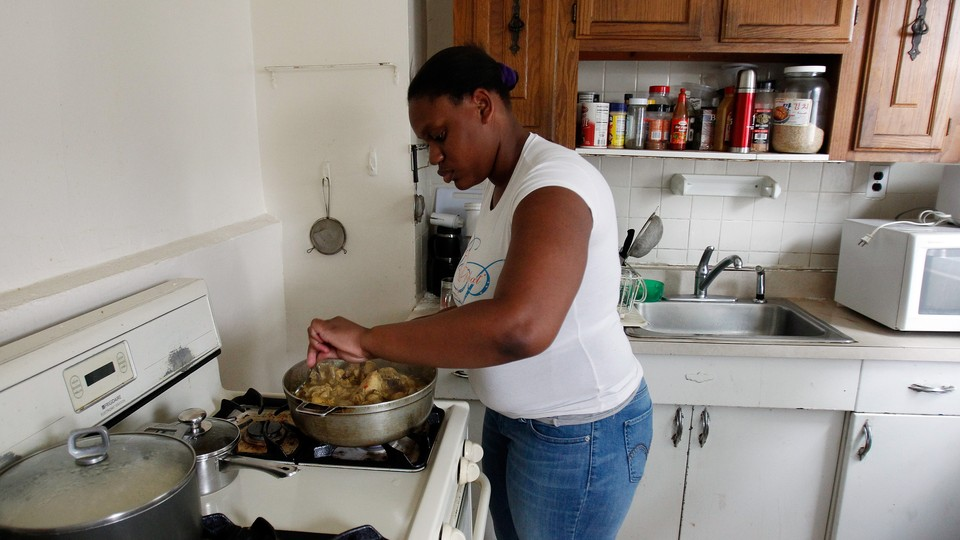 A woman prepares a meal on the stove.