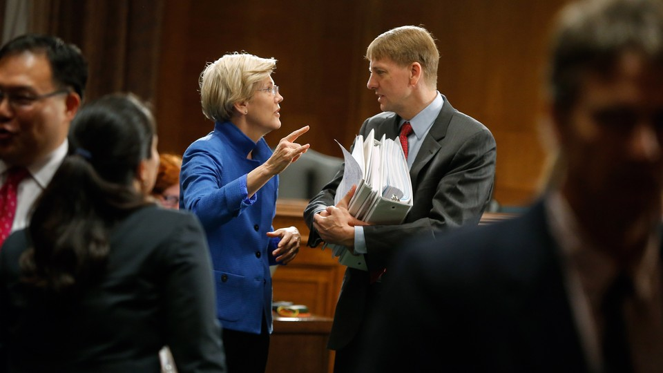 Senator Elizabeth Warren with the CFPB's director, Richard Cordray