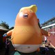 People inflate a Donald Trump blimp to be flown over London during the president's visit
