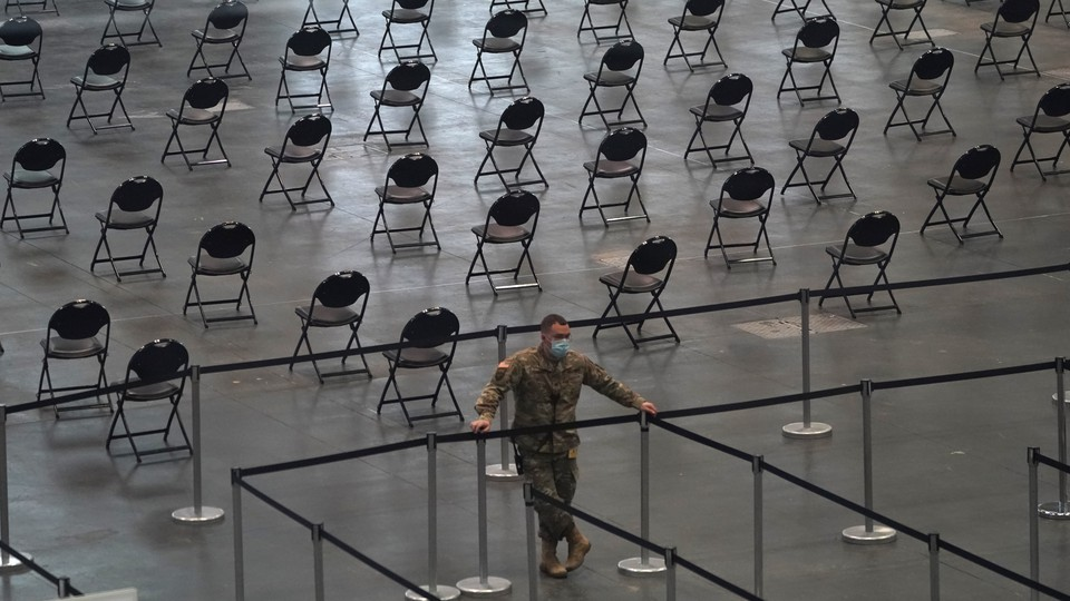 Rows of empty chairs at a mass-vaccination site
