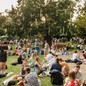 Photo of people picnicking in a park