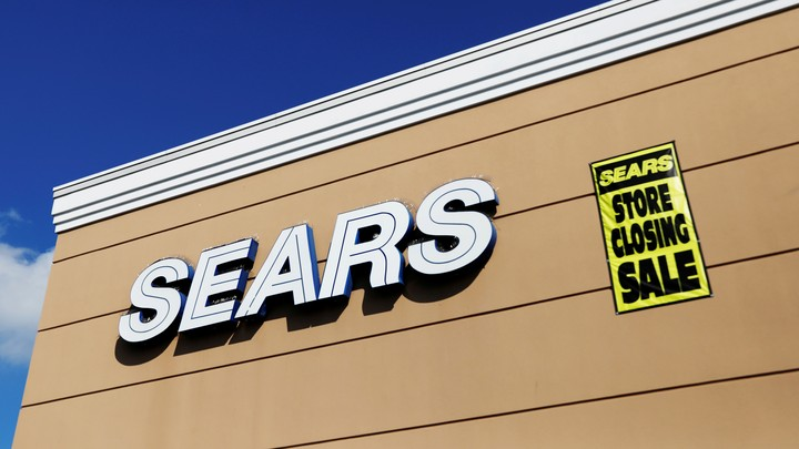 """A """"Store Closing Sale"""" sign on a Sears building"""