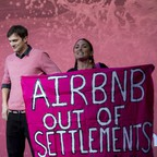 Ashton Kutcher is interrupted by am Airbnb protester at a panel in Los Angeles.