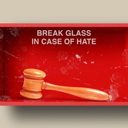 """An illustration of a box that says """"Break glass in case of hate"""" with a gavel inside"""