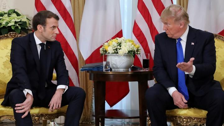 Emmanuel Macron talks with Donald Trump.