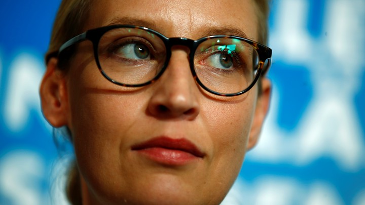 Co-lead AFD candidate Alice Weidel against a blue backdrop.