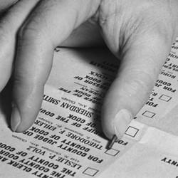 A hand over a ballot