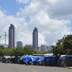 Tents with the Honolulu skyline behind them